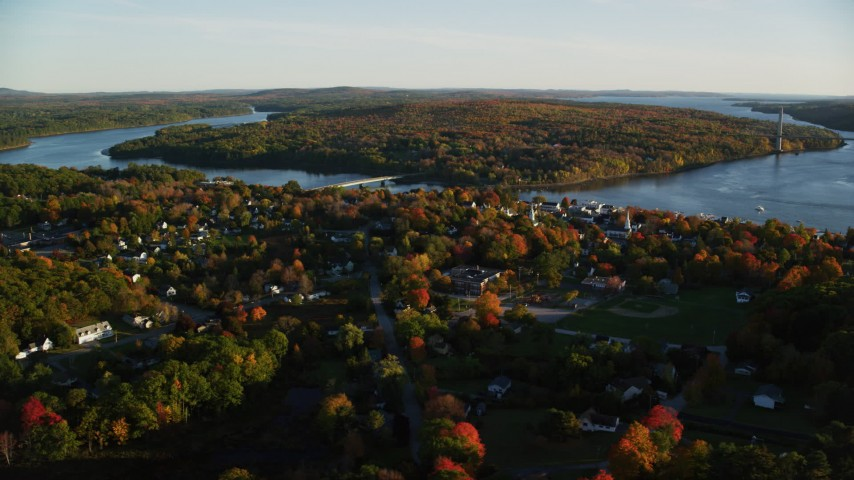 6K aerial video flying by a small town on the Penobscot River in autumn, Bucksport, Maine Aerial Stock Footage | AX149_109