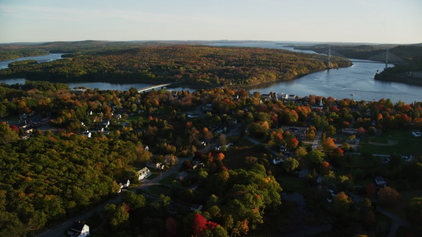 6K aerial video of a wide shot of a small town on the Penobscot River in autumn, Bucksport, Maine Aerial Stock Footage | AX149_110