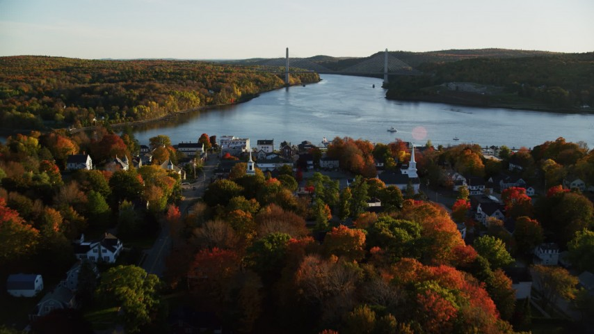 6K aerial video flying over small town, approaching a bridge, autumn, Bucksport, Maine Aerial Stock Footage | AX149_112