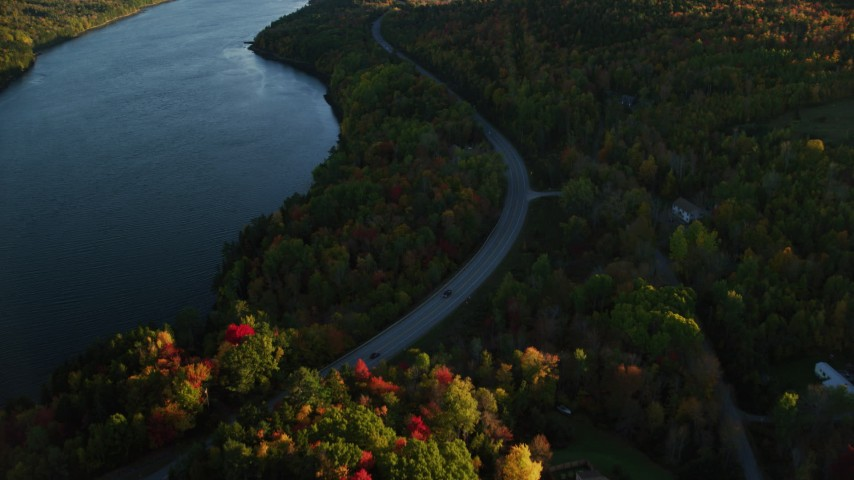 6K stock footage aerial video flying over Route 3 along the river in autumn, Stockton Springs, Maine, sunset Aerial Stock Footage | AX149_116