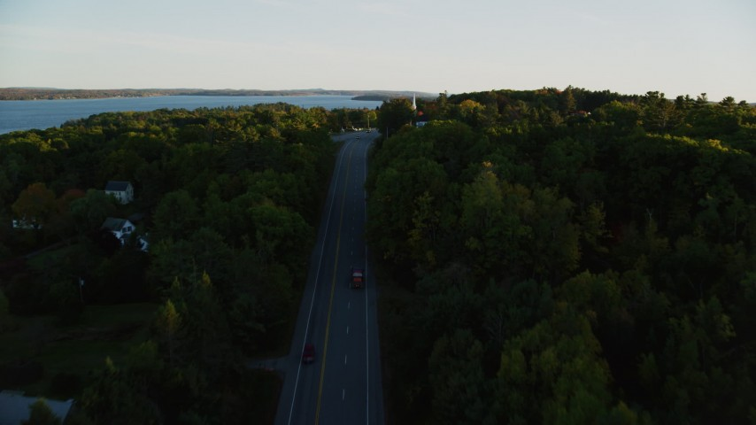6K stock footage aerial video flying over road, approach church, cemetery, autumn, Stockton Springs, Maine, sunset Aerial Stock Footage | AX149_126