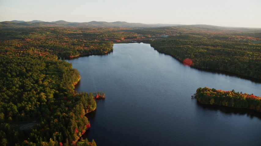 6K aerial video flying over Quantabacook Lake, forest, autumn, Searsmont, Maine, sunset Aerial Stock Footage | AX149_172