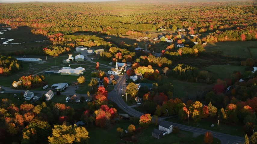 6K stock footage aerial video orbiting a small rural town in autumn, Searsmont, Maine, sunset Aerial Stock Footage | AX149_178