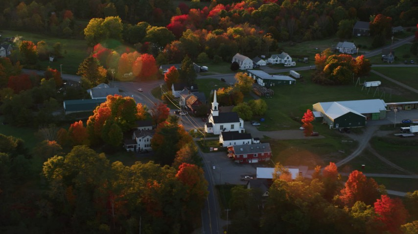 6K stock footage aerial video orbiting small rural town, church, autumn, Searsmont, Maine, sunset Aerial Stock Footage | AX149_181