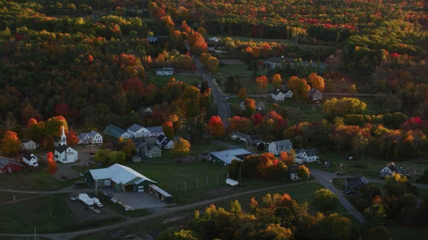 6K aerial video orbiting church in a small rural town, autumn, Searsmont, Maine, sunset Aerial Stock Footage | AX149_182