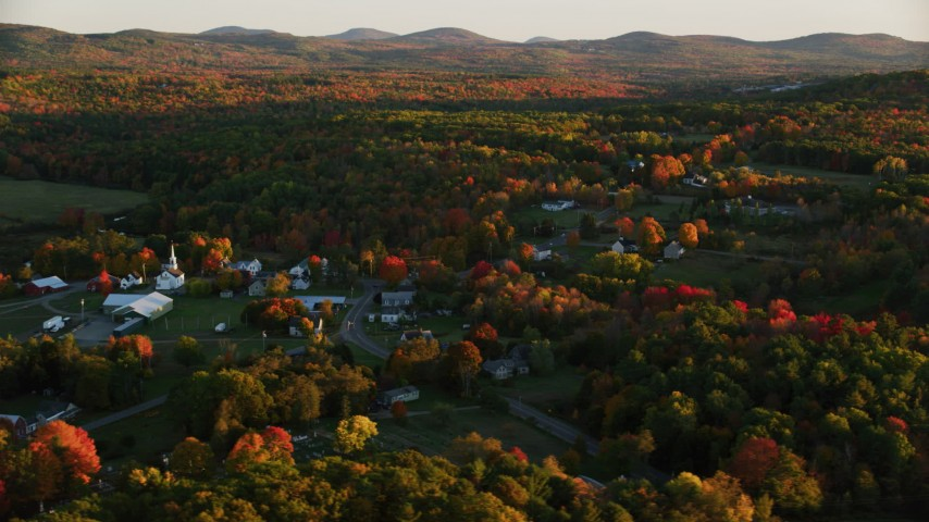 6K aerial video orbiting church, small rural town, colorful trees in autumn, Searsmont, Maine, sunset Aerial Stock Footage | AX149_183