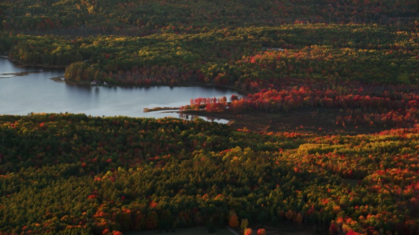 6K stock footage aerial video flying by Sheepscot Pond, colorful forest in autumn, Palermo, Maine, sunset Aerial Stock Footage | AX149_195