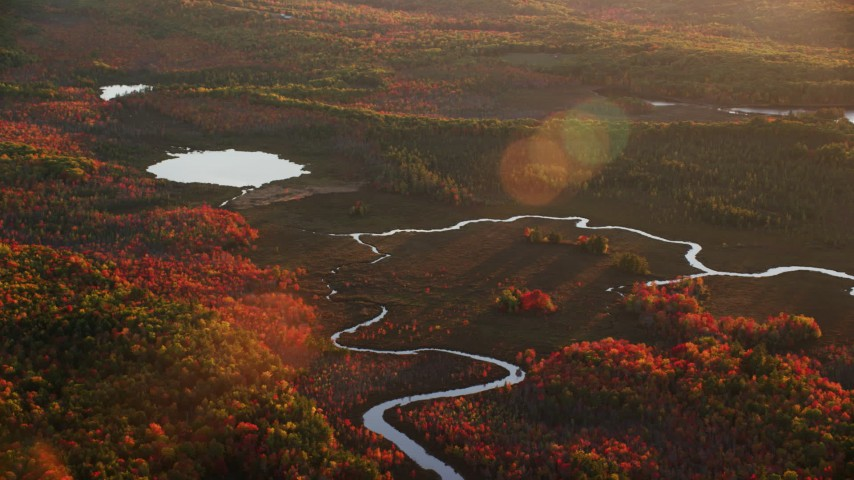 6K stock footage aerial video flying by small rivers leading to a pond, autumn, Palermo, Maine, sunset Aerial Stock Footage | AX149_196