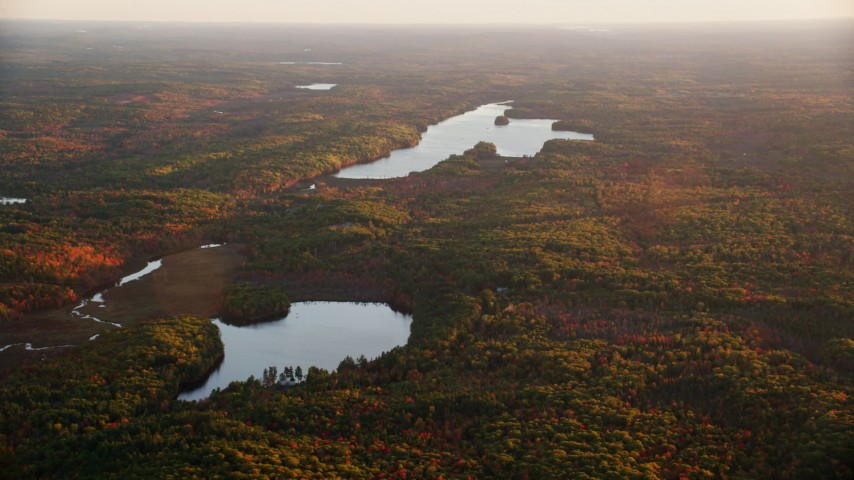6K stock footage aerial video flying by James Pond and Long Pond, forest in autumn, Palermo, Maine, sunset Aerial Stock Footage | AX149_200