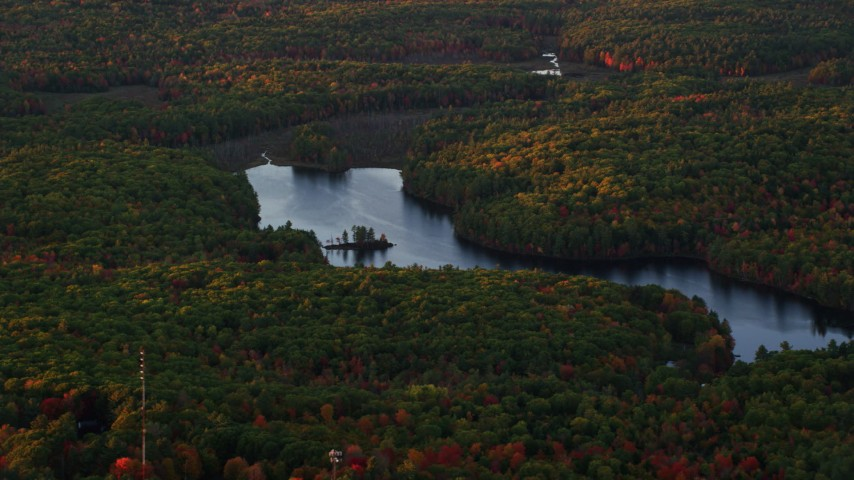 6K stock footage aerial video flying by colorful foliage, Tolman Pond, autumn, Augusta, Maine, sunset Aerial Stock Footage | AX149_212