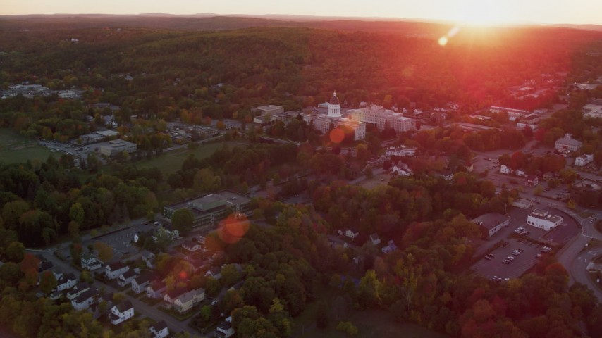 6K stock footage aerial video flying by the Maine State House, autumn, Augusta, Maine, sunset Aerial Stock Footage | AX149_215