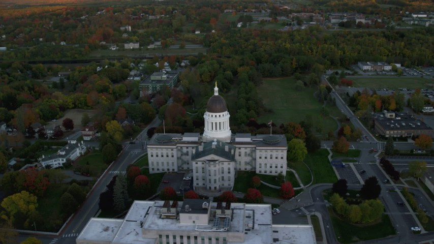 6K stock footage aerial video orbiting colorful trees, Maine State House, autumn, Augusta, Maine, twilight  Aerial Stock Footage | AX149_217