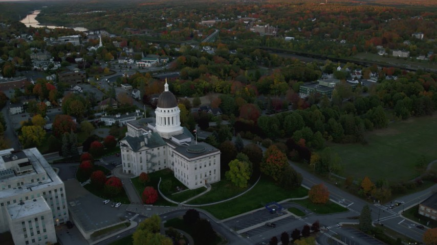 6K stock footage aerial video orbiting the Maine State House, colorful foliage, autumn, Augusta, Maine, twilight Aerial Stock Footage | AX149_218