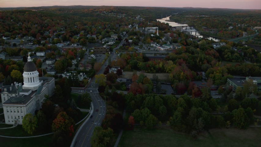 6K stock footage aerial video flying by downtown, Kennebec River, autumn, Augusta, Maine, twilight Aerial Stock Footage | AX149_219