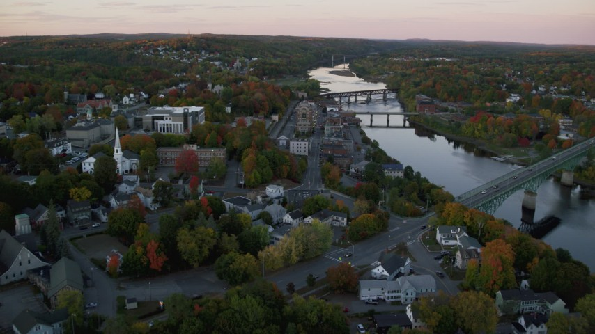 6K stock footage aerial video flying by downtown, small bridges, Kennebec River, autumn, Augusta, Maine, twilight Aerial Stock Footage | AX149_220