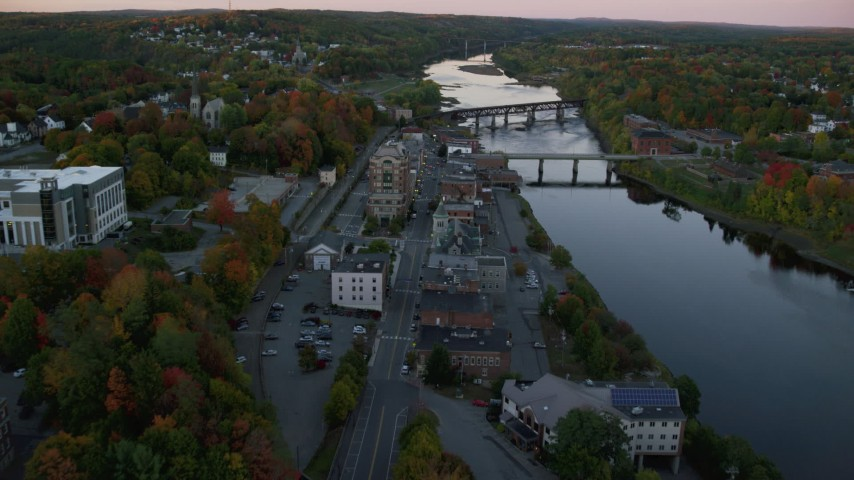 6K stock footage aerial video of Water Street and downtown in autumn, small bridges, Kennebec River, Augusta, Maine, twilight Aerial Stock Footage | AX149_221