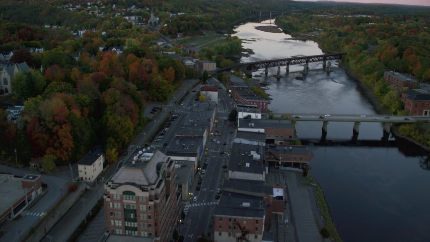6K stock footage aerial video of downtown neighborhood, small bridges, Kennebec River, autumn, Augusta, Maine, twilight Aerial Stock Footage | AX149_222