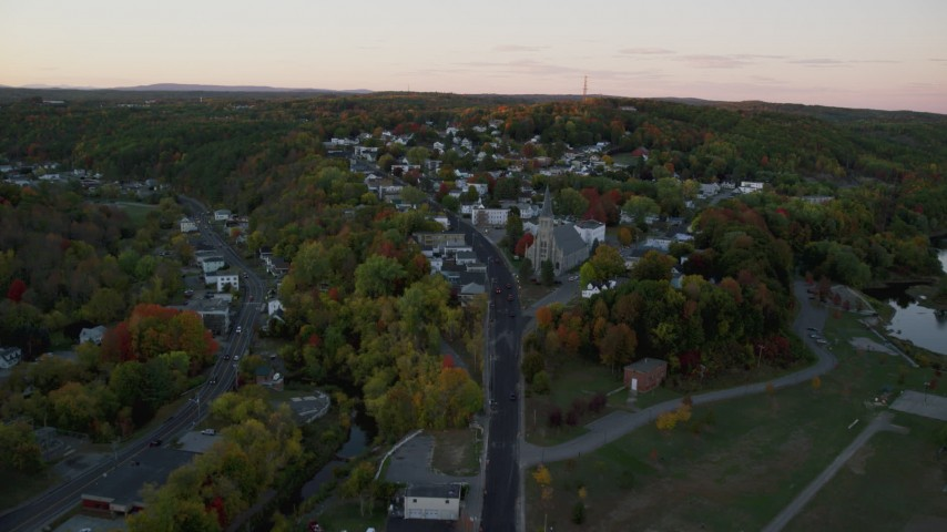 6K stock footage aerial video approaching Saint Augustine Catholic Church, autumn, Augusta, Maine, twilight Aerial Stock Footage | AX149_223