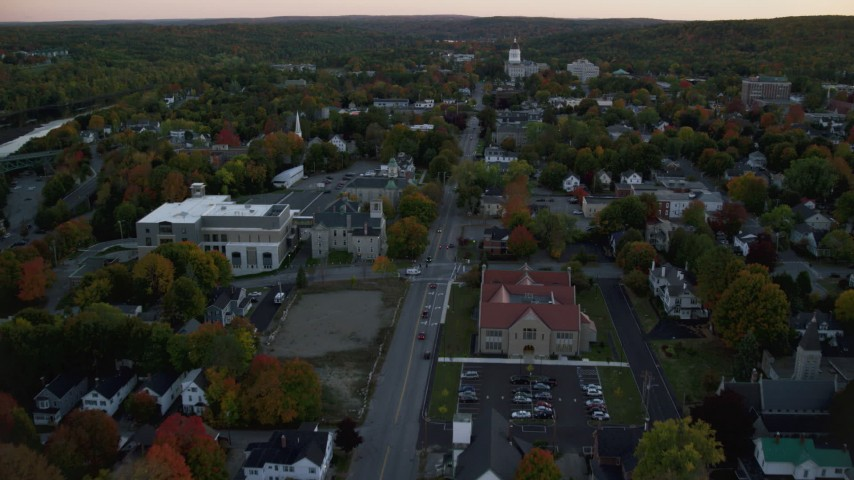 6K stock footage aerial video flying over downtown in autumn, approach Lithgow Public Library, Augusta, Maine, twilight Aerial Stock Footage | AX149_224
