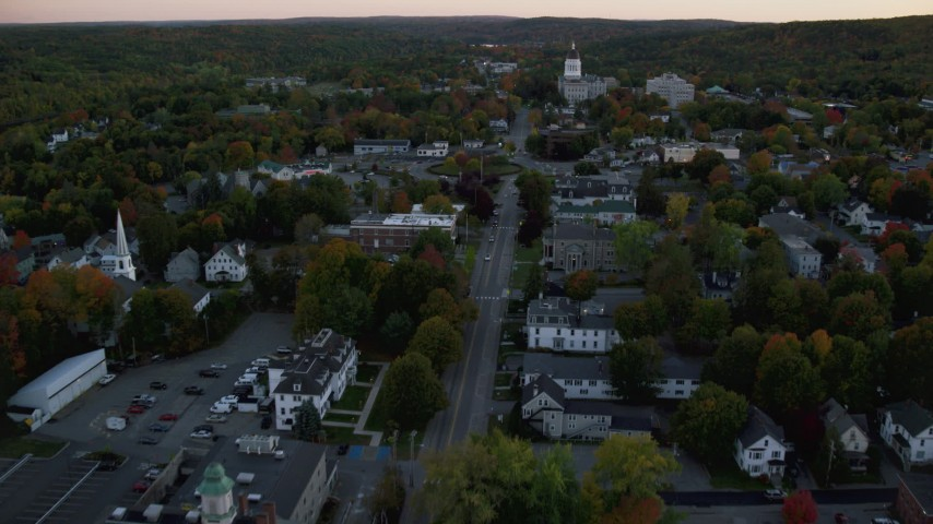6K stock footage aerial video approaching Memorial Circle, Maine State House, autumn, Augusta, Maine, twilight Aerial Stock Footage | AX149_225