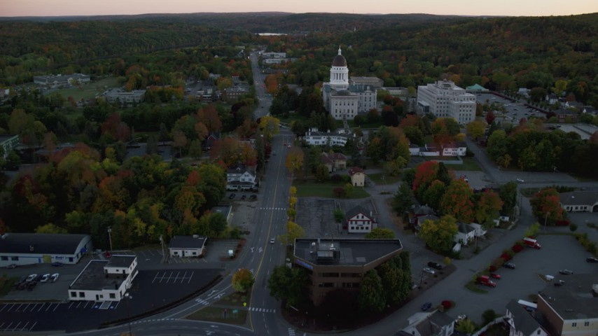 6K stock footage aerial video approaching Memorial Circle, Maine State House, autumn, Augusta, Maine, sunset Aerial Stock Footage AX149_226 | Axiom Images