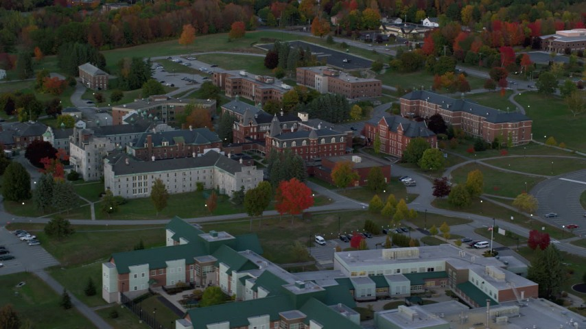 6K stock footage aerial video orbiting Maine government offices, autumn, Augusta, Maine, twilight Aerial Stock Footage | AX149_229