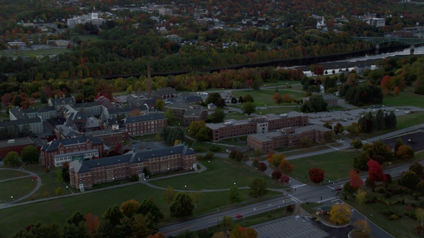 6K stock footage aerial video orbiting Maine government offices, colorful foliage, autumn, Augusta, Maine, twilight Aerial Stock Footage AX149_231