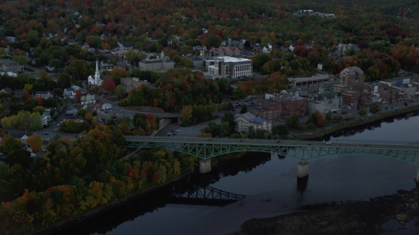 6K stock footage aerial video flying by small bridge, downtown, Superior Court, autumn, Augusta, Maine, twilight Aerial Stock Footage | AX149_234