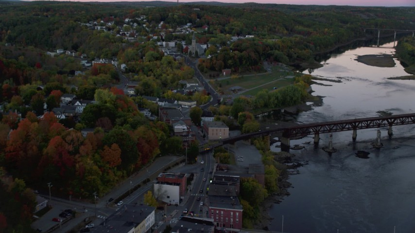 6K stock footage aerial video flying over Northern Avenue, approach Saint Augustine Catholic Church, autumn, Augusta, Maine, twilight Aerial Stock Footage | AX149_236