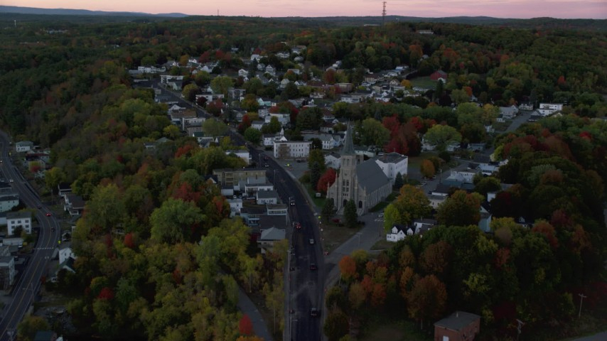 6K stock footage aerial video of Northern Avenue to Saint Augustine Catholic Church, autumn, Augusta, Maine, twilight Aerial Stock Footage | AX149_237