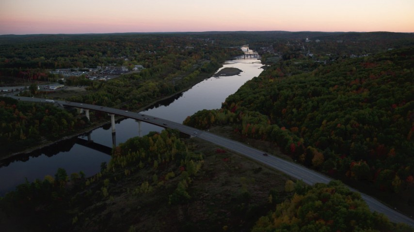 6K stock footage aerial video flying by small bridge, Kennebec River, autumn, Augusta, Maine, twilight Aerial Stock Footage | AX149_241