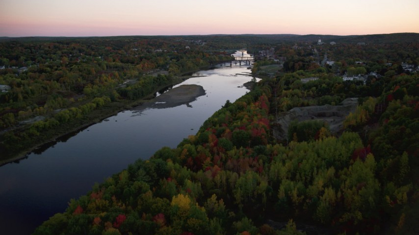 6K stock footage aerial video flying over colorful forest, approach Kennebec River, autumn, Augusta, Maine, twilight Aerial Stock Footage | AX149_243