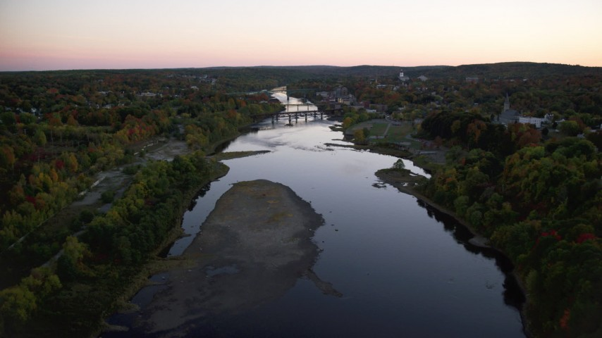 6K stock footage aerial video flying by colorful foliage, small bridge, Kennebec River, autumn, Augusta, Maine, twilight Aerial Stock Footage | AX149_244