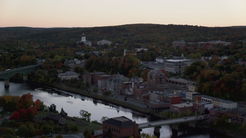 6K stock footage aerial video flying by downtown in autumn, small bridges, Kennebec River, Augusta, Maine, twilight Aerial Stock Footage | AX149_247