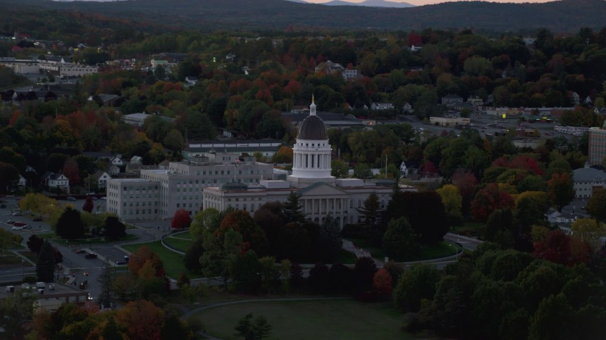 6K stock footage aerial video flying by Maine State House, colorful foliage in autumn, Augusta, Maine, twilight Aerial Stock Footage | AX149_251