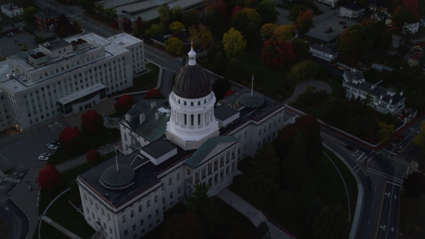6K stock footage aerial video approaching Maine State House, tilt to bird's eye view, autumn, Augusta, Maine, twilight Aerial Stock Footage | AX149_253