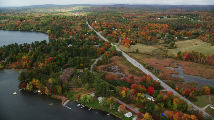 6K stock footage aerial video flying by colorful foliage, waterfront homes, Western Avenue, autumn, Winthrop, Maine Aerial Stock Footage | AX150_007