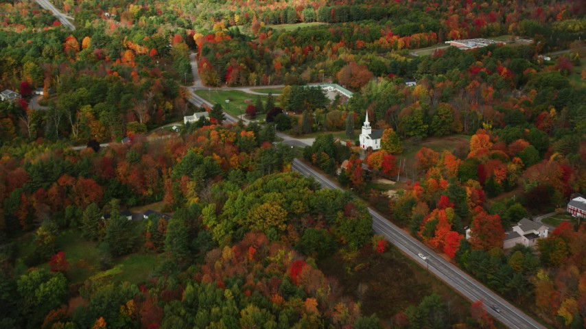 6K stock footage aerial video flying by East Winthrop Baptist Church, Western Avenue, autumn, Winthrop, Maine Aerial Stock Footage | AX150_008