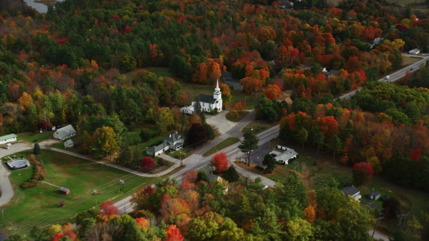 6K stock footage aerial video flying by East Winthrop Baptist Church, colorful foliage, autumn, Winthrop, Maine Aerial Stock Footage | AX150_009