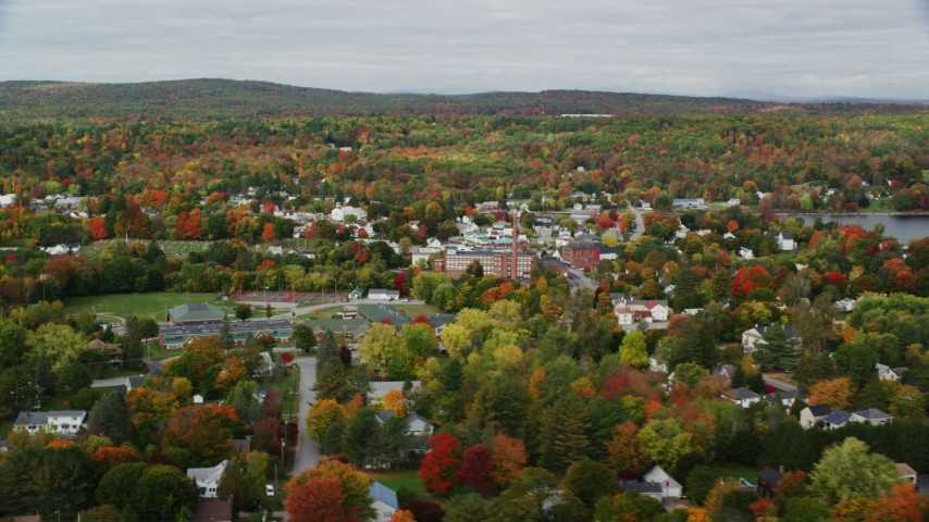 6K stock footage aerial video flying by Winthrop Grade School, small town, autumn, Winthrop, Maine Aerial Stock Footage | AX150_014