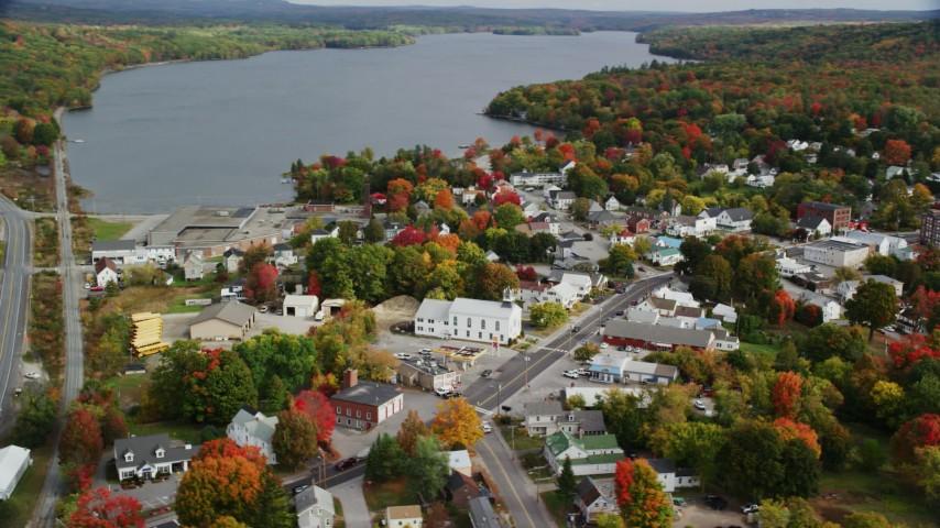 6K stock footage aerial video orbiting Winthrop United Methodist Church, small town, autumn, Winthrop, Maine Aerial Stock Footage   AX150_016