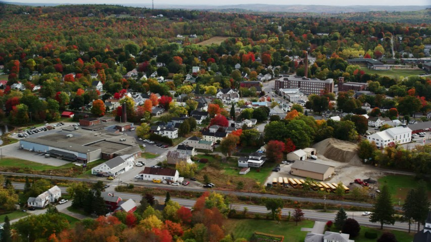 6K stock footage aerial video flying by warehouse and homes, small town, autumn, Winthrop, Maine Aerial Stock Footage | AX150_017