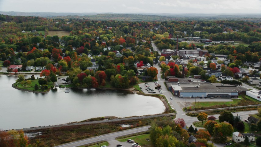 6K stock footage aerial video orbiting homes and small town near water, autumn, Winthrop, Maine Aerial Stock Footage | AX150_018
