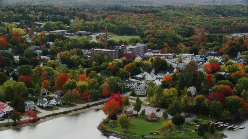 6K stock footage aerial video flying by small town near the water, homes, factory, autumn, Winthrop, Maine Aerial Stock Footage | AX150_019