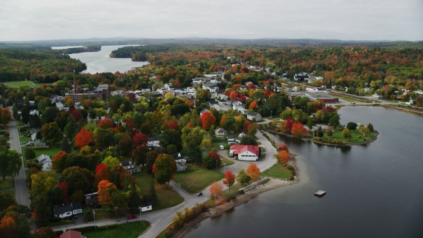 6K stock footage aerial video approaching, flying over homes, small waterfront town, autumn, Winthrop, Maine Aerial Stock Footage | AX150_020