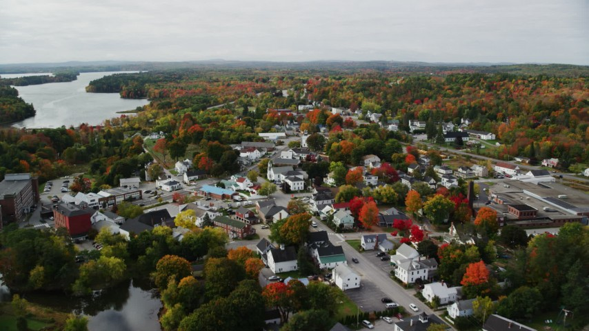 6K stock footage aerial video flying over small town homes, Main Street, tilt down, autumn, Winthrop, Maine Aerial Stock Footage AX150_021 | Axiom Images