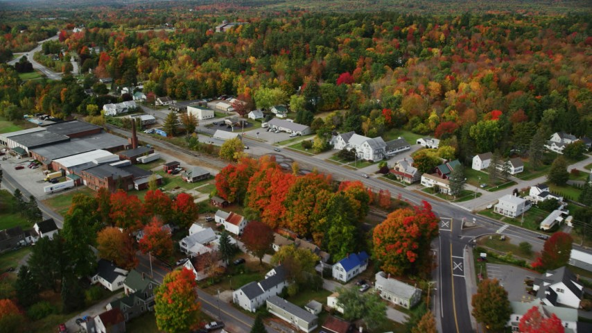 6K stock footage aerial video flying over small town, homes, factory, roads, autumn, Winthrop, Maine Aerial Stock Footage | AX150_022