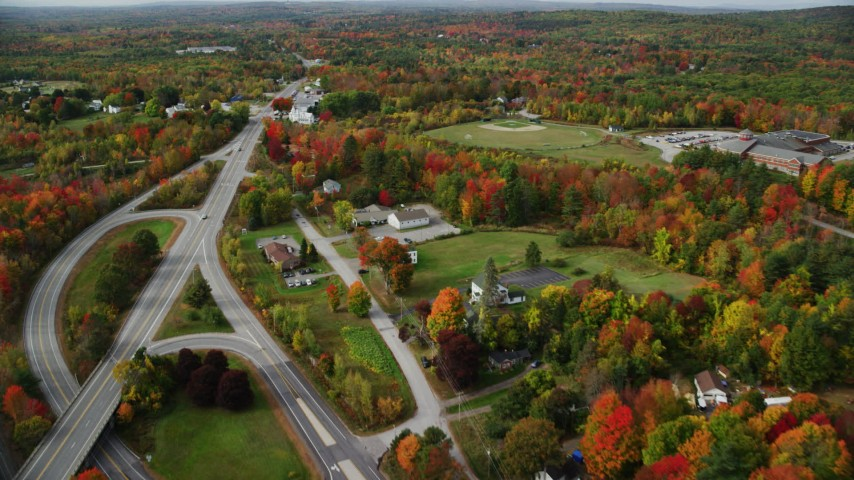 6K stock footage aerial video flying by rural homes near Route 11, Western Avenue, autumn, Winthrop, Maine Aerial Stock Footage   AX150_023