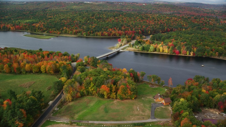6K stock footage aerial video approaching Center Bridge, Androscoggin River, trees in autumn, Leeds, Maine Aerial Stock Footage | AX150_037