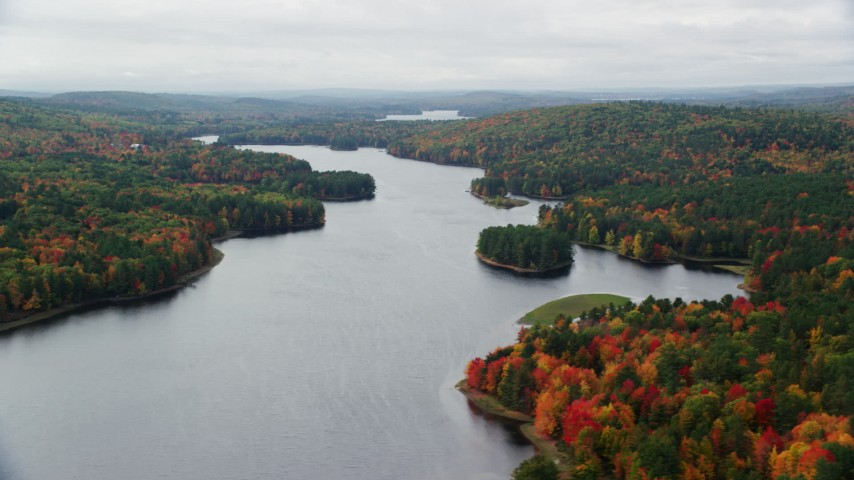 6K stock footage aerial video flying by Androscoggin River, colorful forest in autumn, overcast, Leeds, Maine Aerial Stock Footage | AX150_038